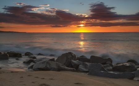 Beautiful sunrise on the beaches of the Costa Brava, Spain Stock Photo