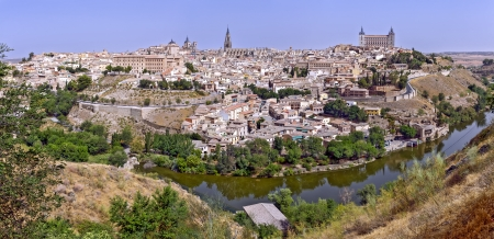 Panoramic view of the historic city of Toledo with river Tajo in Castile-La Mancha, Spain  photo