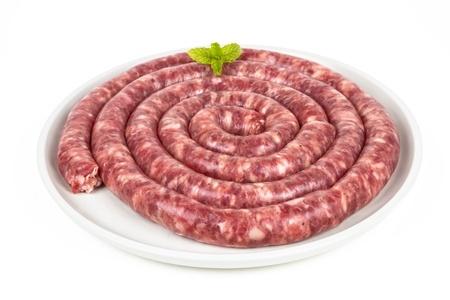 llonganissa: long sausage longaniza of fuets, spanish salami, isolated on a white background