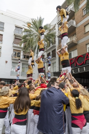 BARCELONA - NOVEMBER 18  Some unidentified people called Castellers do a Castell or Human Tower, typical tradition in Catalonia, on November 18, 2012 in Barcelona, Spain