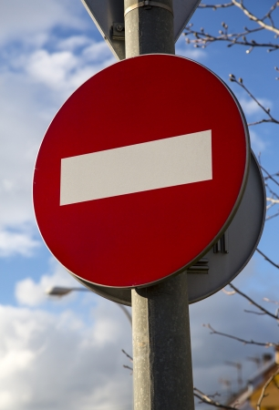 Wrong direction, do not enter red round traffic european  photo