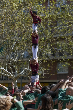 SANT CUGAT, SPAIN - APRIL 07  Some unidentified people called Castellers do a Castell or Human Tower, typical tradition in Catalonia, on April 07, 2013 in Sant Cugat, Spain