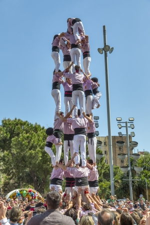 BARCELONA, SPAIN - APRIL 21  Some unidentified people called Castellers do a Castell or Human Tower, typical tradition in Catalonia, on April 21, 2013 in Barcelona, Spain