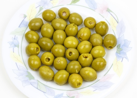 a plate with olives with toothpicks served as tapas on a white background  photo