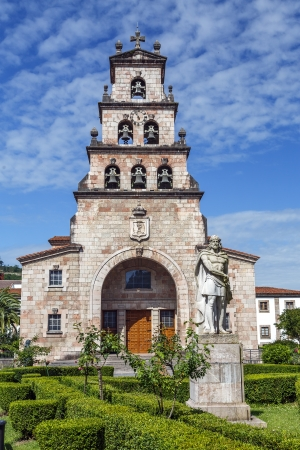 mountin: Church of the Assumption of Cangas de Onis, Asturias Spain and Statue of Don Pelayo, first king of Spain.
