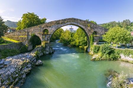 sella: Old Roman stone bridge in Cangas de Onis, Spain  Stock Photo