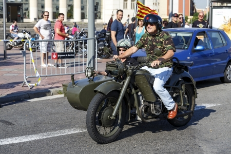 BARCELONA, SPAIN - JULY 07: Unidentified persons with a Harley Davidson motorbike at an exhibition during BARCELONA HARLEY DAYS 2013, on July 07, 2013, Barcelona, Spain. Stock Photo - 20684441