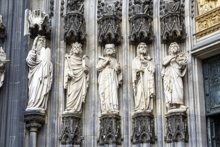 Statues of saints on entry in medieval cathedral in Koeln, Germany  photo