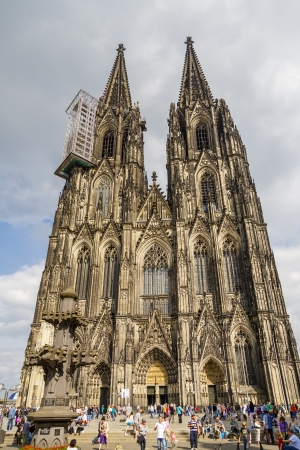 COLOGNE, GERMANY - AOGUST8: people enjoy the view to the dome on August 8, 2013 in Cologne, Germany. It is Germanys most visited landmark attracting ca. 20000 people a day.
