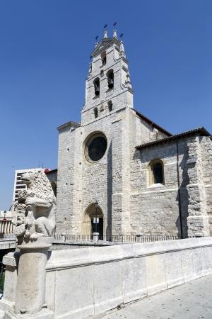 vena: Church of San Lesmes Vena river walk along the San Juan bridge adorned with lion emblazoned, Burgos Spain