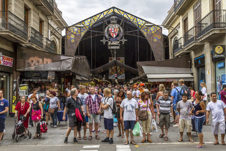 BARCELONA, SPAIN - JULY 21: Main gate at La Boqueria market in July 21, 2012 in Barcelona, Spain. Market has been known since 1217. Now - one of the citys foremost tourist landmarks