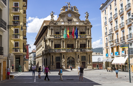 navarra: PAMPLONA, SPAIN - AUGUST 06: Square in front of the Townhall in August 6, 2012 in Pamplona, Spain. The facade of building has been preserved from the 18th century