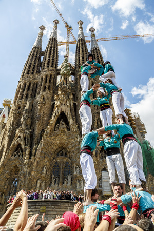 BARCELONA, SPAIN - APRIL 21: Some unidentified people called Castellers do a Castell or Human Tower, typical tradition in Catalonia, on April 21, 2013 in Barcelona, Spain.