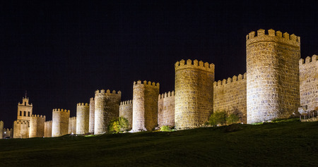 Walls of Avila Spain, night image with artificial lighting. photo
