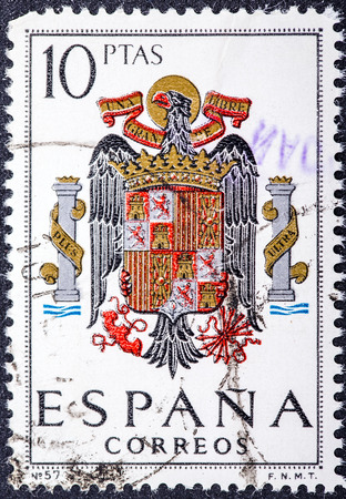SPAIN - CIRCA 1965: A stamp printed in Spain shows shield of Spain during the Franco dictatorship, circa 1965.