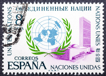 SPAIN - CIRCA 1970: A stamp printed in Spain issued for the 25th anniversary of United Nations shows U.N. Emblem and New York Headquarters, circa 1970.