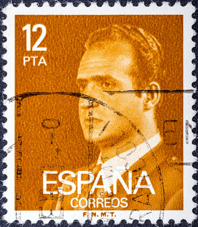 carlos: SPAIN - CIRCA 1976: A stamp printed in Spain shows a portrait of King Juan Carlos I of Spain without inscription, with imprint F.N.M.T, from the series King Juan Carlos I, circa 1976.