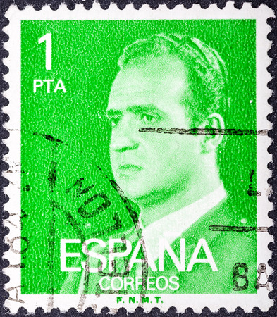 reigning: SPAIN - CIRCA 1976: A stamp printed in Spain shows a portrait of King Juan Carlos I of Spain without inscription, with imprint F.N.M.T, from the series King Juan Carlos I, circa 1976.