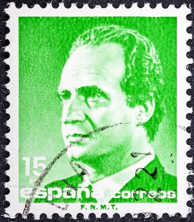 reigning: SPAIN-CIRCA 1990: A stamp printed in Spain shows image portrait Juan Carlos I (baptized as Juan Carlos Alfonso Victor Maria de Borbon y Borbon-Dos Sicilias) is the reigning King of Spain, circa 1990.  Editorial