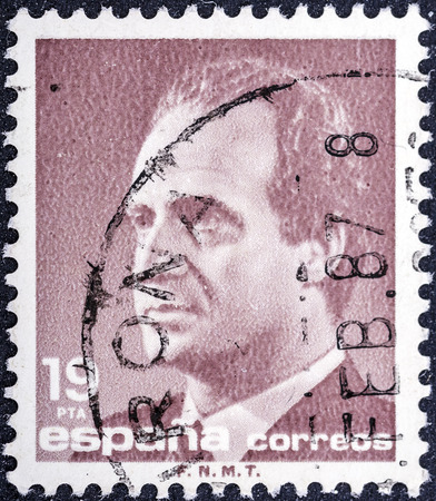 baptized: SPAIN-CIRCA 1990: A stamp printed in Spain shows image portrait Juan Carlos I (baptized as Juan Carlos Alfonso Victor Maria de Borbon y Borbon-Dos Sicilias) is the reigning King of Spain, circa 1990.  Editorial