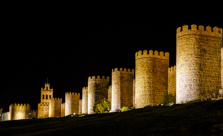 Walls of Avila Spain, night image with artificial lighting.
