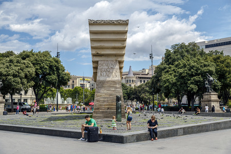 BARCELONA, SPAIN - JUNE 29, 2014: Macia Monument in Plaza Catalunya in Barcelona, Spain. This monument designed by Subirachs in honor of president dominates the square, the city centre.
