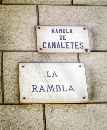 ramblas: Barcelona landmark - La Rambla street sign in wal, Spain.