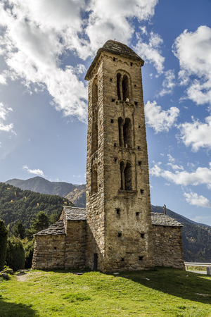 architectural feature: Romanesque church Sant Miquel d%uFFFDEngolasters whose main architectural feature is the bell tower, with stories having mullioned windows and Lombard archs.     Stock Photo