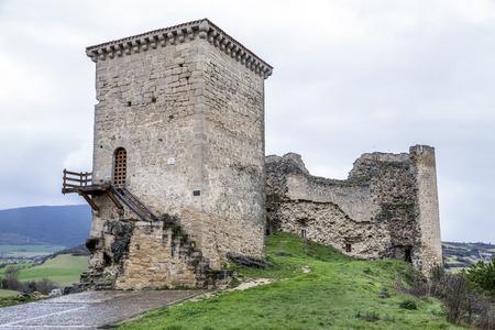 cid: Castle of Santa Gadea del Cid with a dark sky in Burgos, Spain