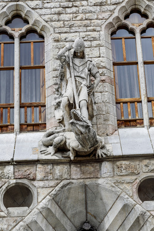 stone of destiny: Botines Palace in Leon, Spain. Detail on the facade of St. George the Dragon