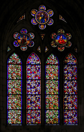 leon: LEON, SPAIN - MAR 23, 2015: Medieval stained glass with floral details, made with techniques leaded, in the cathedral of Leon, Castille and Leon, Spain.