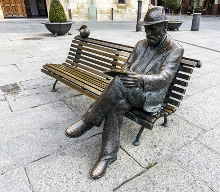 treads: LEON, SPAIN - MAR 23, 2015: Bronze statue of Antonio Gaudi in Leon by Jos� Luis Fern�ndez, his work Against House Treads, is the only building designed and built by Gaud� in the city of Le�n.