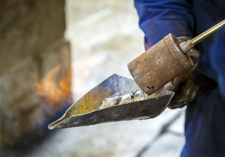 compostela: Lead melting torch to repair windows Cathedral of Santiago de Compostela. Stock Photo
