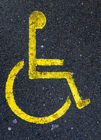 Sign painted on asphalt forbidden to park in handicapped zone photo