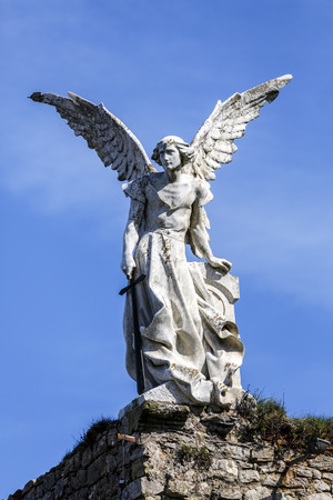angel cemetery: Sculpture of a Guardian angel with a sword in the cemetery of Comillas. Cantabria - Spain