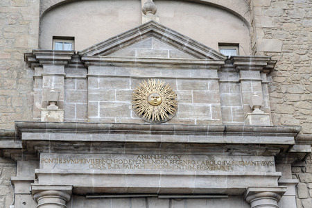 urban scenics: detailed sun symbol of the city in the archway to Solsona, Spain. Capital of comarca of Solsones, Lleida province.