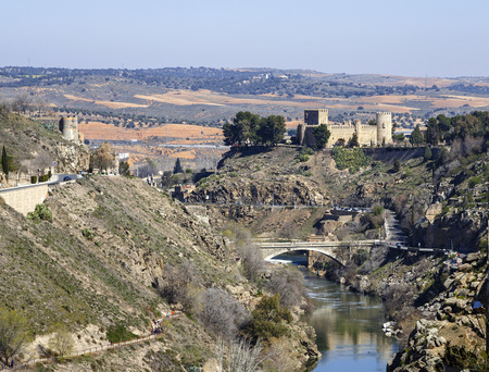 declared: Toledo, Spain - March 13 , 2016: San Servando Castle is located in the city of Toledo, Spain, along the banks of the Tagus River and the Infantry Academy. In 1874 he was declared a national artistic monument.