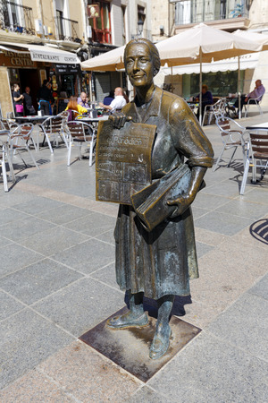 gomez: Caceres, Spain - March 16, 2016: The statue of the popular selling Leoncia Gomez Galan Extremadura, the last town crier of Extremadura newspaper.