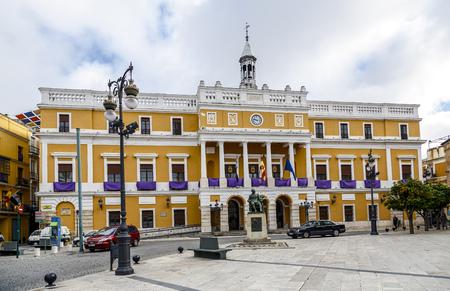 badajoz: Badajoz, Spain - March 19, 2016: City of Badajoz City Hall, with ornate balconies violet, to celebrate the holidays of Easter. Editorial