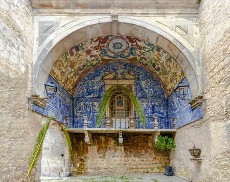 eighteenth: Obidos, Portugal - March 20, 2016: Porta da Vila is the main entrance of the town of Obidos. This is a double door in spill with tiled inside eighteenth century Editorial