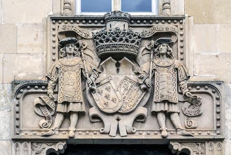 heralds: Ciudad Rodrigo Spain, Palacio de la Marquesa de Cartago, S. XIX, neo-Gothic style, and built with stone from Villamayor. On the front door are two escutcheons, with two heralds as tenantes. Editorial