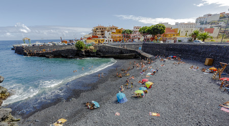 greatly: Garachico, Spain - August 16, 2015:  Garachico beaches and Atlantic ocean. Tenerife island, Canary. Spain. tourist place and greatly appreciated by tourists from around the world
