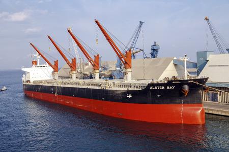 tonnes: Genoa, Italy - September 27, 2015: The ship ALSTER BAY in Genoa port is a Buque granelero registered in Panama. Has a deadweight of 55430 tonnes and was built in 2008. The gross tonnage is 30816. Editorial