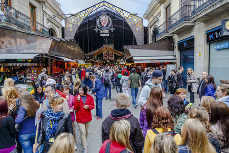 boqueria: Barcelona, Spain - March 30, 2013: Tourists in famous La Boqueria market. One of the oldest markets in Europe that still exist. Established 1217. Editorial
