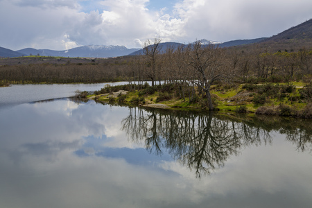Reservoir of the Pontoon at the foot of the mountain Penalara, in the Farm of San Ildefonso. Segovia Spain Stock Photo