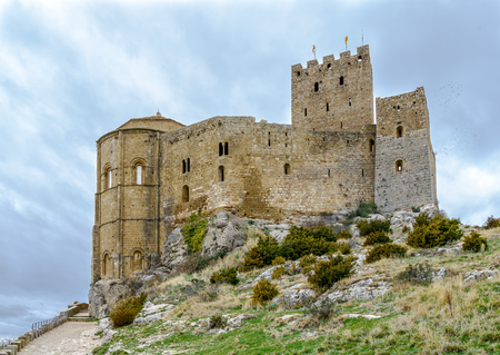 bastion: Medieval castle of Loarre over the rocks in Aragon, Spain Stock Photo