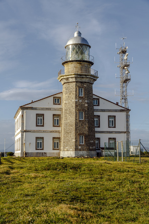 Beautiful lighthouse in Asturias in northern Spain Bay of Biscay, Faro Cabo Penas Stock Photo