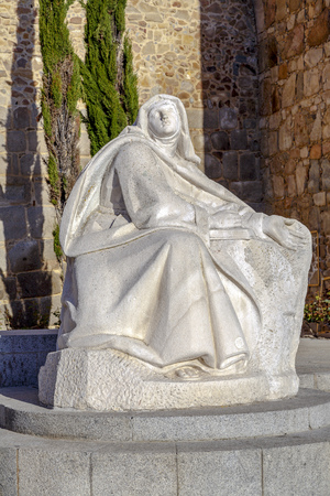 theologians: Avila, Spain - April 18, 2014:  Monument of Saint Teresa of Avila, Placed along with the south wall of the city Editorial