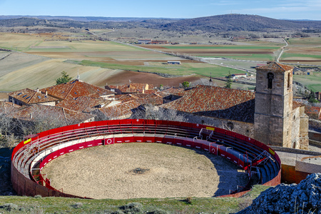 Bullring next to Holy Trinity Church and a view over Atienza town, Guadalajara, Spain