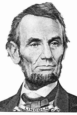 abraham lincoln's portrait on front of a five dollar bill.